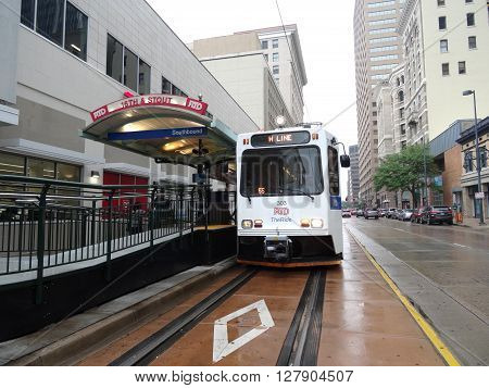 DENVER COLORADO - JULY 7: RTD - The Ride - H Line light rail stops at 16th and Stout station on a rainy day in Denver Colorado on July 7 2015.