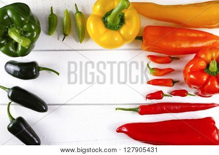 Mexican hot chili peppers colorful mix paprika poblano serrano jalapeno on white wooden board