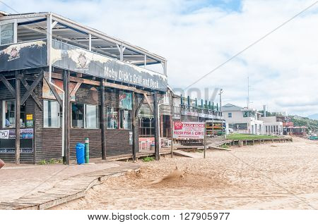 PLETTENBERG BAY SOUTH AFRICA - MARCH 3 2016: Restaurants and the building of the National Sea Rescue Institute the beach at Beacon Island