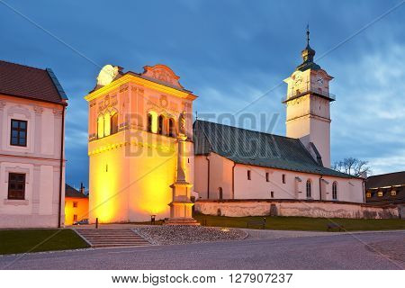 Church and bell tower in the square of Spisska Sobota, Slovakia.
