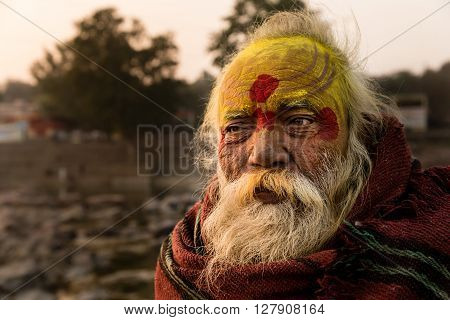 ORCHHA INDIA - JANUARY 29 2014: A Sadhu (holyman) at sunset near the Betwa river Orchha Madhya Pradesh state India.