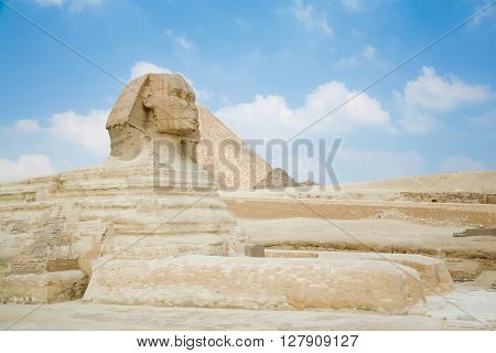 landmark of famous Great Sphinx from century XXVI Before Christ and behind the Great Pyramid of Khufu in Giza next to Cairo city Egypt Africa