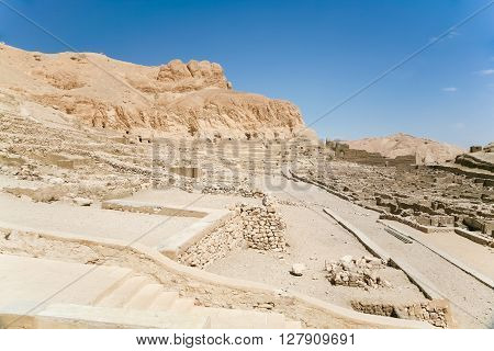 landscape of ruins of landmark Egyptian city Deir el-Medina monument ancient village of artisans who worked in tombs of Kings Valley in Luxor Egypt Africa
