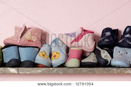 Baby's shoes on a shelve at the nursery