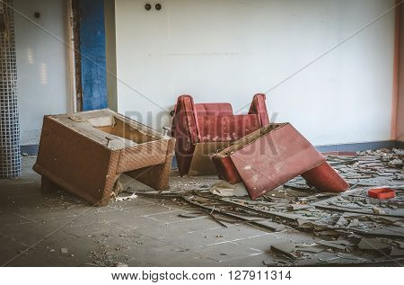 Old ruined building. Old chairs and rubble in abandoned house.