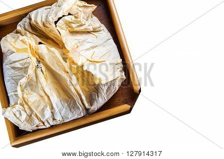 Pu-erh tea on wood background and rice paper