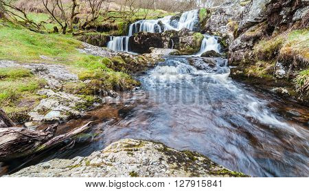 Wild Waterfall Background with Streaks of Flowing Water