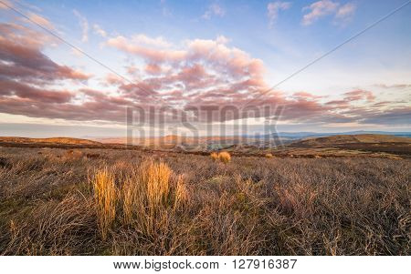 Warm Susnet Clouds Over Heather Valley in North Wales