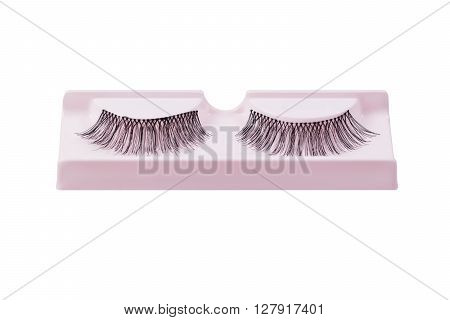 False eyelashes pair on pink display isolated on white background