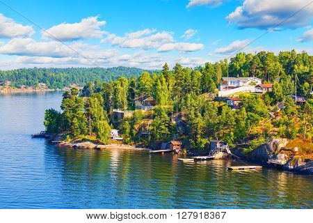 Scenic summer Scandinavian Swedish countryside landscape - sea islands forests and villages with cottages