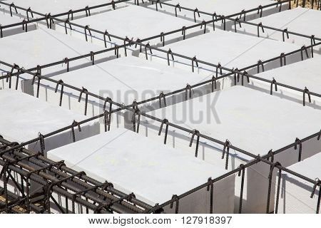 Iron framework and polyurethane  to build a foundation for a building