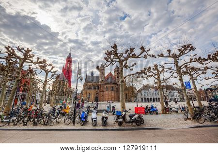 Maastricht Netherlands - April 11 2016: Vrijthof in Maastricht with unidentified people. Vrijthof the largest and best-known square in Maastricht with many well-known pubs and restaurants
