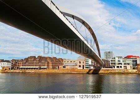 Maastricht Netherlands - April 11 2016: modern bridge over the river Meuse in Maastricht. Maastricht is a university city and the capital of the Dutch province Limburg