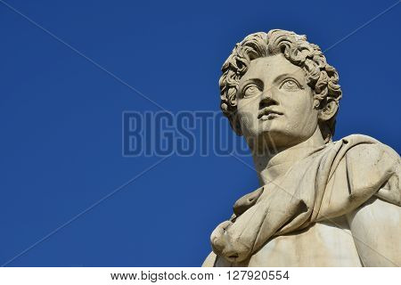 Marble head from the ancient roman statue of Dioskouri at the top of Capitoline Hill staircase and balustrade in the center of Rome (1st century BC)