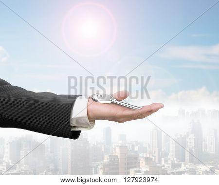 Man Hand Holding Silver Key