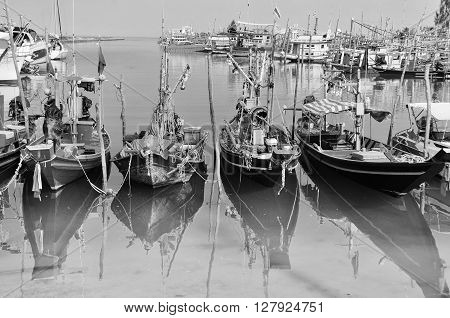 Fisherman village at Koh Samui, Thailand. Many fishing boats moored. Black and white
