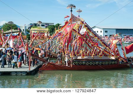 Semporna Sabah Malaysia - Apr 22 2016 : People visiting traditional Bajau's boat called Lepa Lepa decorated with colorfull Sambulayang sail parading during annual Regatta Lepa Festival in Semporna Sabah.