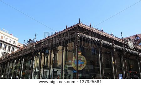 Madrid Spain - April 8 2016: Ornate front of San Miguel Market Madrid Spain. Madrid Spain - April 8 2016