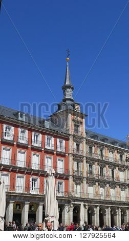 Madrid Spain - April 8 2016: People and buildings in Plaza Mayor in Madrid. Madrid Spain - April 8 2016: