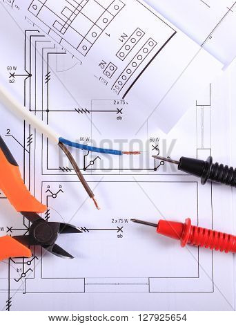 Cables of multimeter metal pliers electric wire and construction drawings electrical drawings and tools for engineer jobs