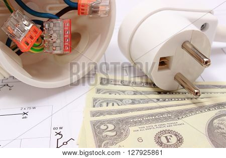 Copper wire connections in electrical box electric plug and money on construction drawing of house concept for engineering and energy savings