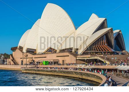 Sydney Australia - November 8 2014: Sydney Opera at Sydney Australia. As the sun sets and casts warm golden color. A large amount of tourists visit here everyday.