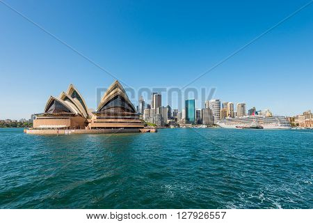 Sydney Australia - November 9 2014: The Sydney Opera and the Circular Quay cruise terminal at Sydney Australia. Cityscape of Sydney Downtown in a beautiful day.
