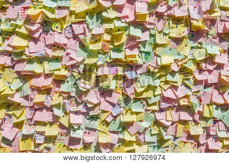 Sydney Australia - November 9 2014: People post the memo notice requests and wishes. Hundreds of post it are pinned on the notice-board at Manly beach Sydney Australia.