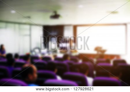 Blur image of peoples on the conference rooms in the University and light