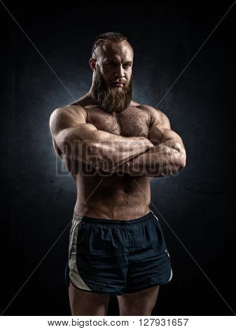 Bodybuilder Topless Over Grunge Background.