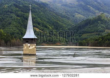 Flooded church in polluted lake by mining in Romania