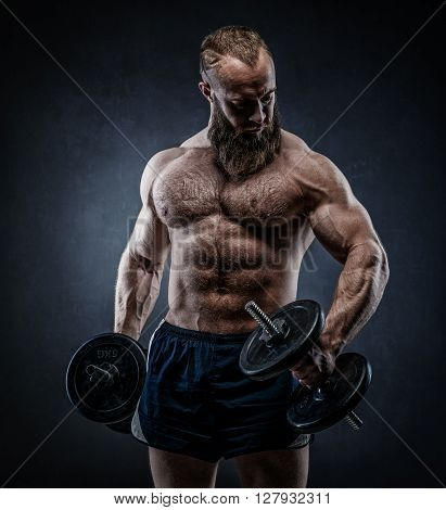 Power Athletic Bearded Man In Training Pumping Up Muscles With Dumbbell