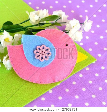 Pink felt bird toy, faux white flowers
