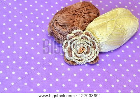 Crochet flower, two skeins cotton yarn. Background with copy space for text