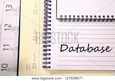 Database text concept write on notebook .