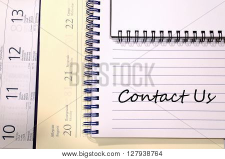 Contact us text concept write on notebook