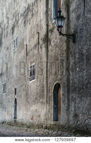 Facade of authentic medieval house used as storehouse or granary in the past ages