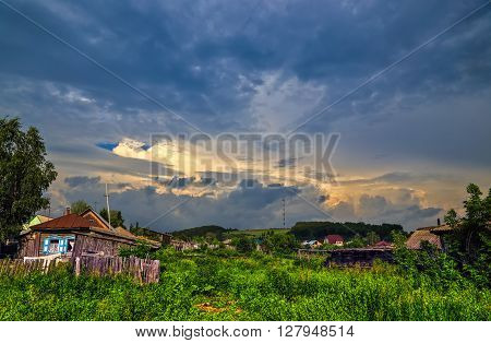 Beautiful sunset sky over Russian village in Siberia