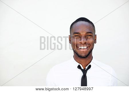 Portrait Of Smiling Young African Businessman