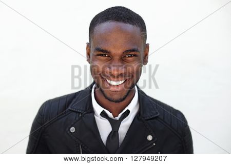 Happy Young Male Fashion Model In Leather Jacket And Tie
