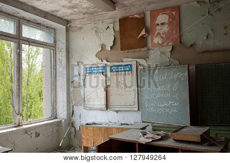 Pripyat, Ukraine - May 9, 2011: Abandoned school office in Pripyat, Chernobyl Exclusion Zone, place of Chernobyl nuclear disaster in Ukraine. Every year on May 9 people, evacuated from Exclusion Zone, are allowed to visit their former homes.