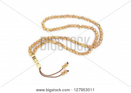 Closeup of brown rosary isolated on white background
