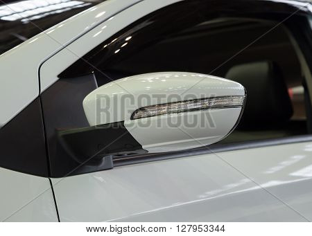 Rear view mirror of new white car