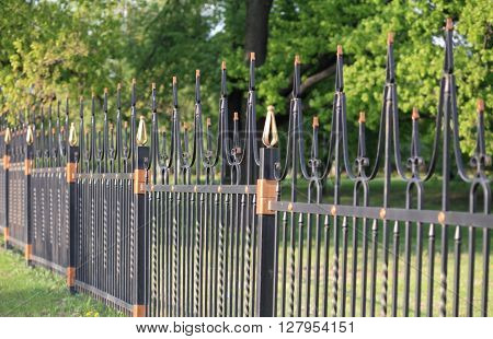 image of many fence with gold decoration