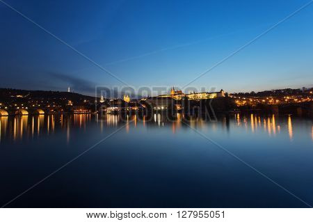 Prague city at night Charles Bridge Lobkowicz Palace Hradcany and Prague Castle reflection in Vltava river. Prague Czech Republic