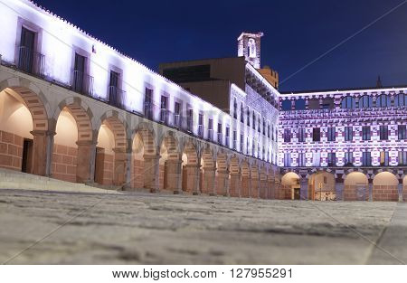 Hight square of Badajoz illuminated by led lights at twilight. Low angle view from the floor