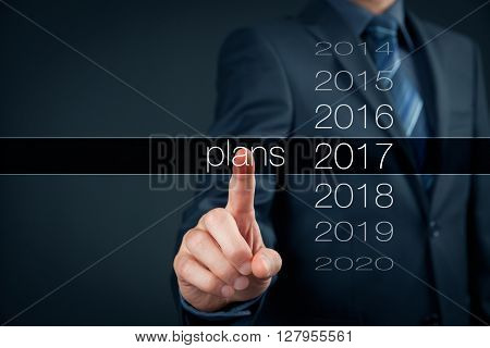 Businessman planning year 2017. Business new year plans goals and targets concept.