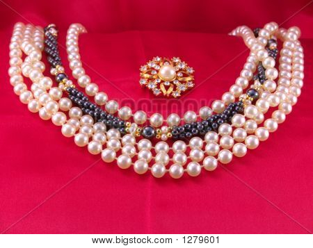 Pearls And Brooch