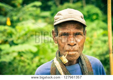Man With Smoking Pipe