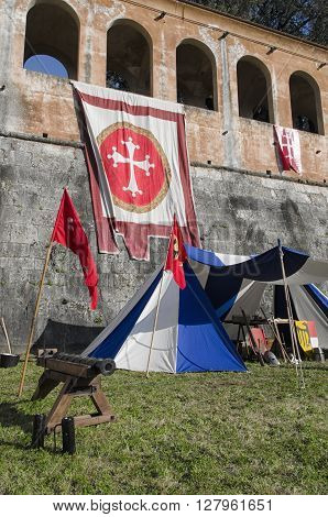 Pisa, Italy - March 26, 2016: Tents and cannon in historical re-enactment in Pisa